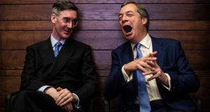 "Brexiteers Jacob Rees-Mogg and Nigel Farage, who said if Brexit was obstructed he would ""don khaki, pick up a rifle and head for the front lines"". Photograph: Jack Taylor/Getty Images"