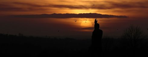 ULSTER'S OPPORTUNITY: Birds scatter as the sun sets in front of the statue of Sir Edward Carson at Stormont in Belfast. Photograph: Niall Carson/PA Wire