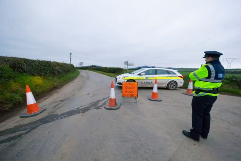 ROAD CLOSED: Gardai near a location where human remains were found on Monday morning in the townland of Ballyandrew, near Ferns, Co Wexford. Photograph: Patrick Browne/The Irish Times