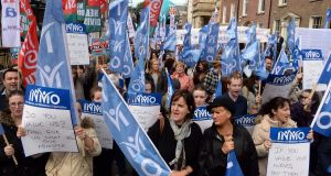 Members of the Irish Nurses and Midwives Organisation protesting over conditions of employment outside Leinster House two years ago. File photograph: Eric Luke/The Irish Times