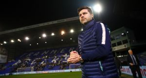 Tottenham Hotspur manager  Mauricio Pochettino inspects the pitch prior to the FA Cup third-round match against  Tranmere Rovers  at Prenton Park. Photograph: Clive Brunskill/Getty Images