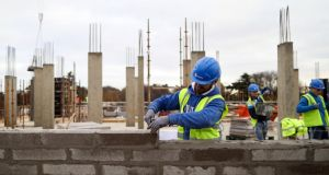 A construction worker lays a row of bricks on the Cairn Homes Plc Marianella residential construction site in Dublin in November 2016. Photograph: Chris Ratcliffe/Bloomberg