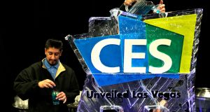 Bartenders pour blue cocktails through an ice sculpture at CES in Las Vegas on January 7th. Photograph: Rick Wilking/Reuters