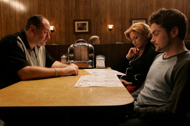 Fade to black: James Gandolfini, Edie Falco and Robert Iler in The Sopranos' final scene. Photograph: Craig Blankenhorn/HBO