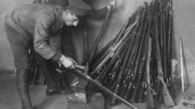 1919: German soldiers destroying rifles in accordance with the requirement for Germany to disarm, as laid down by the Treaty of Versailles. Photograph: Three Lions/Getty Images
