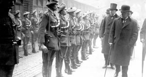 British prime minister David Lloyd George with his cabinet colleagues Andrew Bonar Law and Sir Hamar Greenwood inspecting officer cadets of the auxiliary division of the Royal Irish Constabulary in the quadrangle of the UK foreign office. Photograph: Hulton Archive/Getty Images