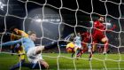 Manchester City's John Stones clears the ball off the line away from Liverpool's Mohamed Salah during the Premier League game at the Etihad stadium. Photograph: Phil Noble/Reuters
