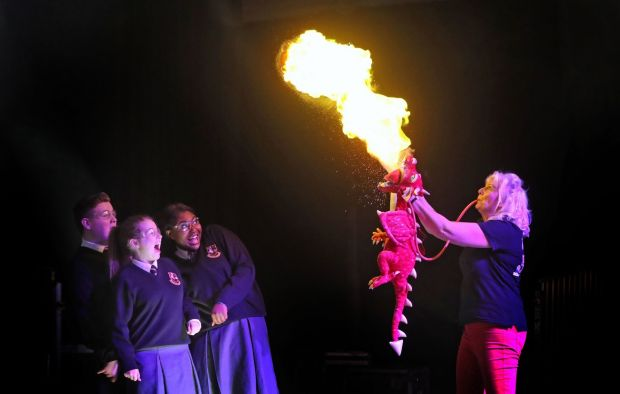 Sue McGrath (Scientific Sue) demonstrate how dragons work for Sophie Kelly (16), Rachelle Biayi (16) and Karl Fitzpatrick (15) at the launch of the 2019 BT Young Scientist & Technology Exhibition Photograph: Niall Carson/PA Wire