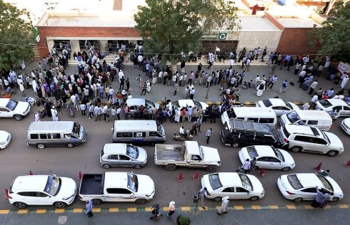 CASHING IN: People queue to withdraw money from an ATM in Khartoum, Sudan. Photograph: Mohamed Nureldin/Reuters