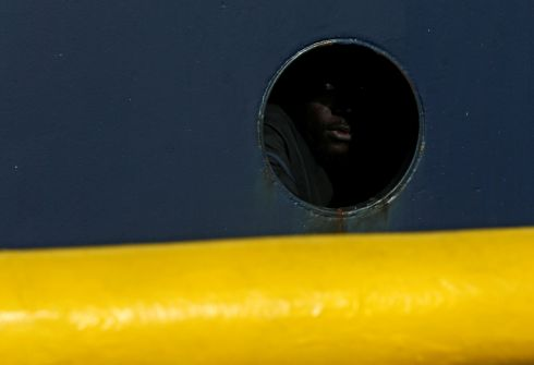 SEA EYE: A migrant looks out from a porthole on the deck of the migrant search-and-rescue ship Professor Albrecht Penck, operated by German NGO Sea-Eye, off the coast of Malta. Photograph: Darrin Zammit Lupi/Reuters