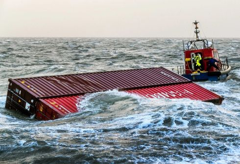 WATERLOGGED: A tugboat tows two containers which fell overboard from the ship MSC Zoe to harbour in Lauwersoog, the Netherlands. Reports state the vessel lost at least 270 shipping containers at sea during a heavy storm on January 2nd. Content from containers has washed up on the Netherlands' North Sea islands.  Photograph: Remko De Wall/EPA