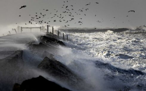 TUMULTUOUS WAVES: Large waves hit a pier on the North Sea coast of the Netherlands during a storm. Photograph: Koen Van Weel/EPA