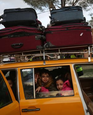 BACK TO GAZA: Palestinian children gesture inside a car loaded with suitcases upon their return to Gaza from Egypt, at the Rafah border crossing in the southern Gaza Strip. The crossing had been closed to Palestinians, a border official said. Photograph: Said Khatib/AFP/AFP/Getty Images
