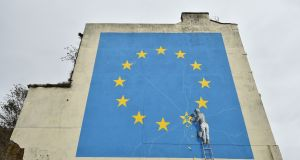 A mural in Dover by British artist Banksy depicts a workman chipping away at one of the stars on an EU-themed flag. Photograph: Lyn Kirk/AFP/Getty Images