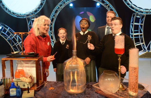 Sue McGrath, AKA 'Scientific Sue', with students Sophie Kelly, Rachelle Biayi and Karl Fitzpatrick, from Pobalscoil Neasain, Baldoyle, Dublin and Shay Walsh, Managing Director for BT Ireland, at the launch of the BT Young Scientist & Technology Exhibition Photograph: Dara Mac Dónaill/The Irish Times