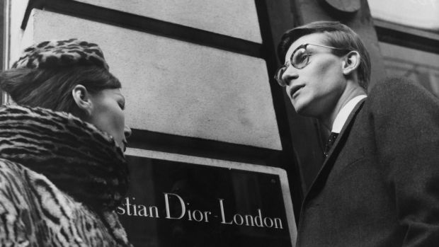 French fashion designer Yves Saint Laurent (1936 - 2008) in London, 11th November 1958. He is preparing for the following day's Dior Autumn collection show to an audience including Princess Margaret, at Blenheim Palace. Photograph: Popperfoto/Getty Images