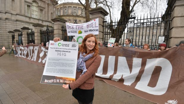 Kate Ruddock from Friends of the Earth with colleagues from Love Leitrim and Trinity Divest Fossil Fuels at an anti Fracking protest outside the Dáil. Photograph: Alan Betson/The Irish Times