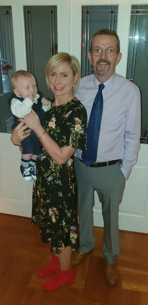 Caleb on his Christening day with Cliodna and Enda.