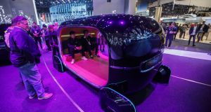 Attendees sit inside a Kia  Motors simulator demonstrating the real-time emotion adaptive driving  system. Photograph: Patrick T Fallon/Bloomberg