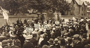 "Cumann na mBan protesting outside Mountjoy Prison in 1921 during the Irish War of Independence. Placards read ""Mother of God, open the prison gates""; ""Release our Fathers and Brothers""; and ""Mother of Mercy, pray for prisoners""."