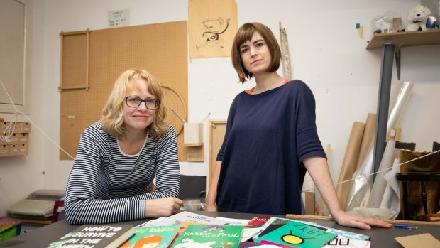 Debbie Jenkinson and Sarah Bowie with an array of small-press publications, demonstrating the breadth of comic-creation talent in the country. Photograph: Tom Honan