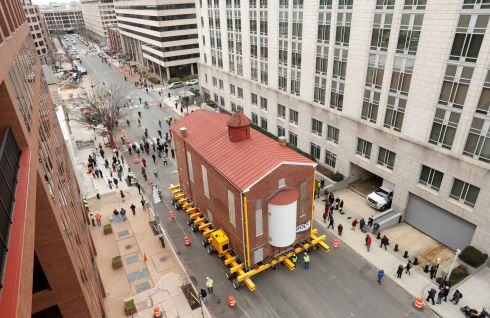 ON THE MOVE: Washington's first and oldest synagogue, Adas Israel synagogue, is moved via a remote controlled platform to its new location where it will become be the cornerstone of the Capital Jewish Museum on in the city. Photograph: Kevin Lamarque/Reuters