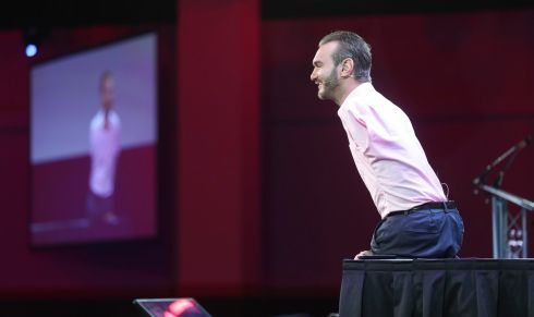NO LIMITS: Guest speaker Nick Vujicic giving his talk titled 'attitude is altitude' on the main stage at the Pendulum Summit in Dublin. The Australian was born with tetra-amelia syndrome, meaning he was born with no arms and no legs. Photograph: Conor McCabe Photography