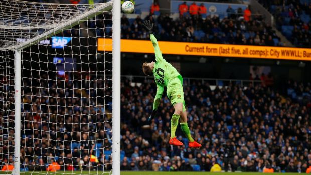 Bradley Collins watches as Oleksandr Zinchenko's shot flies over his head for City's fourth. Photo: Phil Noble/Reuters