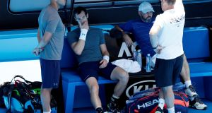 Andy Murray talks to his team after his practice match against Serbia's Novak Djokovic. Photograph: Kim Kyung-Hoon/Reuters
