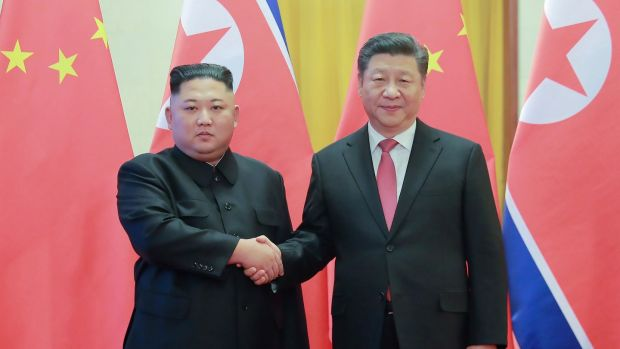 Kim Jong-un with China's President Xi Jinping in Beijing. Photograph: KCNA via KNS/AFP/Getty Images