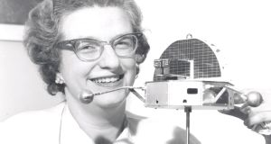 Nancy Roman in 1962 with a model of an orbiting solar observatory. Roman was Nasa's first director of astronomy and a leading advocate for the Hubble space telescope. She died on Christmas Day, aged 93. Photograph: Nasa via The New York Times