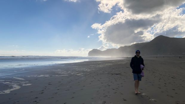 Paul Gillick enjoying the beach in New Zealand