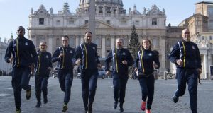 Members of the first Vatican athletics team in front of St. Peter's Basilica. Photograph: Maurizio Brambatti/EPA