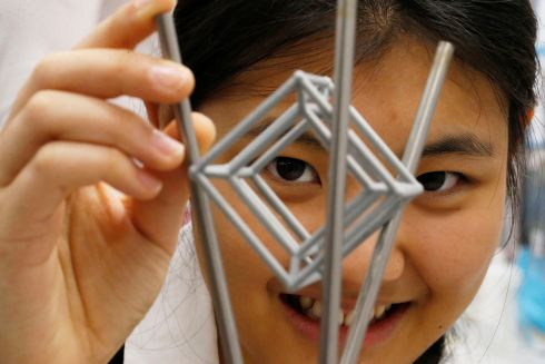 THINKING OUTSIDE THE BOX: Tianyiwa Xie, a student from Alexandra College, Dublin,  with her project 'Intersection of Multidimensional Planes in Projective Geometry' at the BY Young Scientist and Technology exhibition.  Photograph: Nick Bradshaw for The Irish Times