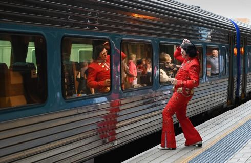 MYSTERY TRAIN: An Elvis fan uses the train window as a mirror at Central Railway Station before boarding a train to the Parkes Elvis Festival, in Sydney, Australia. Photograph: Peter Parks/AFP/Getty Images
