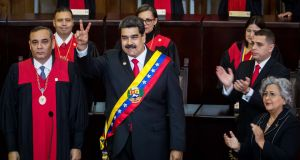 Nicolas Maduro poses after being sworn-in for the second term as Venezuela's president  in Caracas on Wednesday.  Sinn Féin has defended its attendance at the event. Photograph: Miguel Gutierrez/EPA.