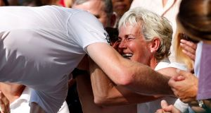 Andy Murray celebrates with his mother Judy after winning in Wimbledon in 2013. Photograph: PA