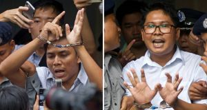 Reuters journalists Kyaw Soe Oo and Wa Lone being escorted by police out of the court in Yangon, Myanmar on September  3rd, 2018. Photograph: Thein Zaw/AP
