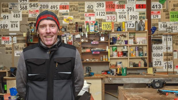 """It's a bit of a mess. I can't wait to get home again."" Damien Martin, whose home is across the road from Magheracloone GAA pitch and community centre, in his workshop. Photograph: Pat Byrne"