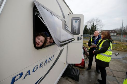 EVICTION: The Halting site on the Balgaddy Road, Clondalkin, where the resident travel families are facing eviction from the site. Council officials (right) in discussion with resident's of the site.  Photograph Nick Bradshaw/The Irish Times