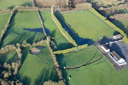 SINKING FEELING: Aerial view of a large sinkhole in Co Monaghan on the grounds of the Magheracloone Mitchells GAA Club and community centre. Photograph: Pat Byrne