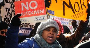 Federal workers and contractors rally against the partial federal government shutdown. Photograph: Chip Somodevilla/Getty Images