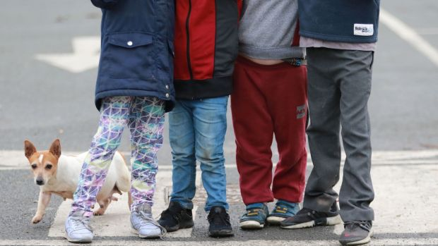 A dog and some of the 28 children who live on the halting site at Balgaddy Road in Clondalkin. Photograph: Nick Bradshaw/The Irish Times.