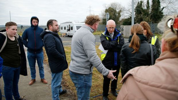 Residents of a halting site on the Balgaddy Road in Clondalkin and their supporters speak to South Dublin County Council officials at the site on Friday. Photograph: Nick Bradshaw/The Irish Times.