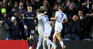 Leeds celebrate after Jack Harrison scored their second against Derby County. Photograph: Simon Cooper/PA