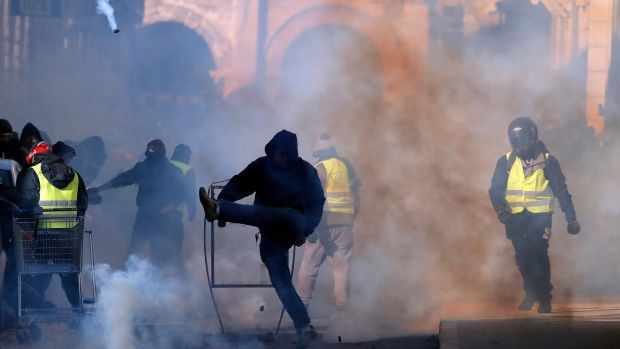 Street protests in Nimes where violence erupted among a fog of tear gas. Photograph: EPA