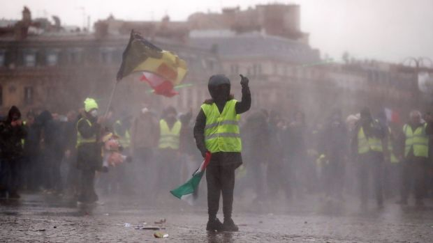A protester during a demonstration near the Arc de Triomphe. Photograph: Reuters