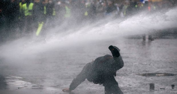 Police Use A Water Cannon During Demonstration By The Yellow Vests Movement Near Arc