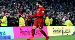 Liverpool's Mohamed Salah celebrates scoring a penalty against Brighton. Photograph: PA