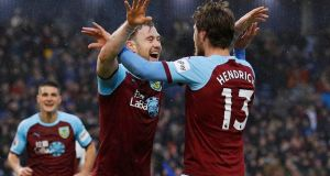 Burnley's Ashley Barnes and Jeff Hendrick celebrate Fulham's second own goal. Photograph: Reuters